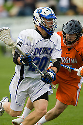 Duke midfielder Steve Schoeffel (20) runs past Virginia midfielder Steve Giannone (5).  The #2 ranked Duke Blue Devils defeated the #3 ranked Virginia Cavaliers 11-9 in the finals of the Men's 2008 Atlantic Coast Conference tournament at the University of Virginia's Klockner Stadium in Charlottesville, VA on April 27, 2008.