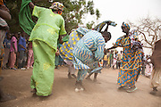 Dancers perform for the village chief of Barani during the FECHIBA horse festival in northern Burkina Faso.