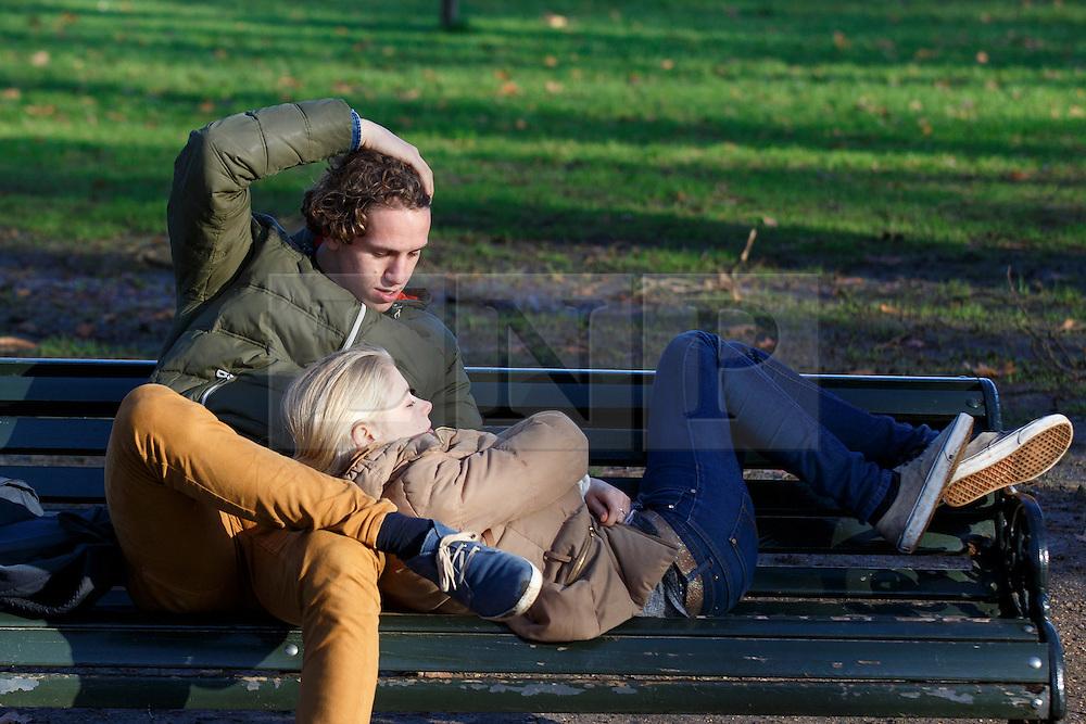 © licensed to London News Pictures. London, UK 02/01/2014. People enjoying the sunshine in Green Park, London on Thursday, January 2, 2014. Photo credit: Tolga Akmen/LNP