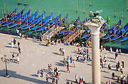 Gondolas and tourists in Piazza San Marco (St. Mark's Square), Venice, Veneto, Italy