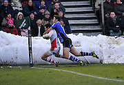 Matt Banahan of Bath Rugby tackles Adam D'Arcy of Ulster Rugby at a snow bank moved from the pitch. Heineken Cup Round 4 Bath Rugby vs Ulster Rugby at the Recreation Ground, Bath, England. 18th December 2010
