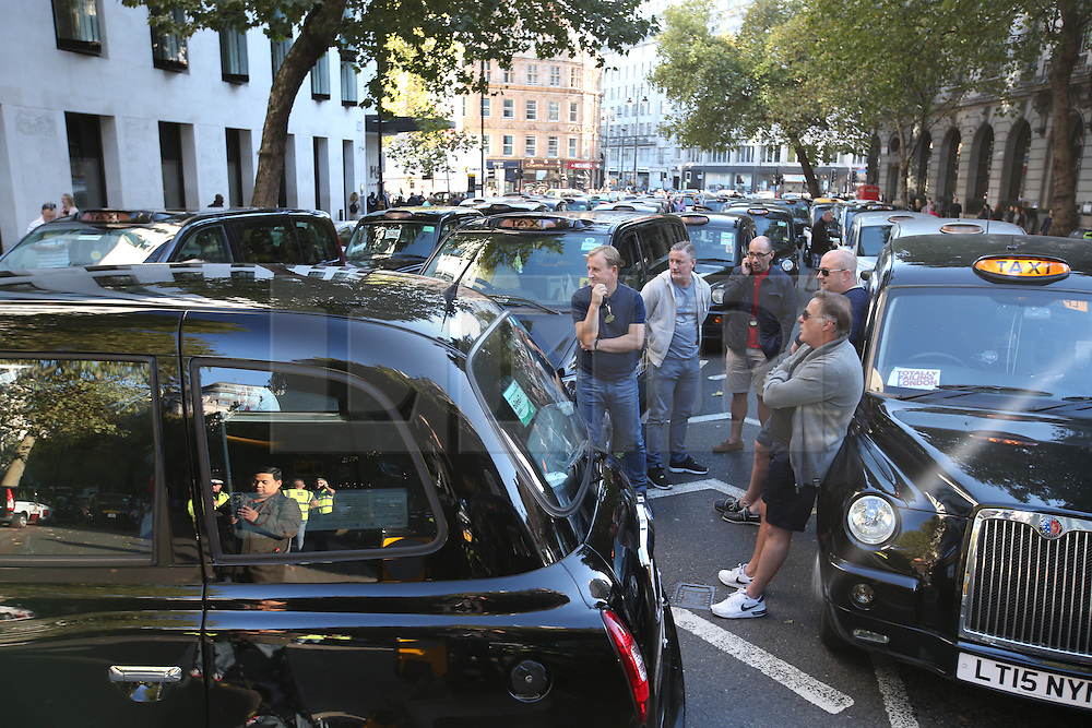 © Licensed to London News Pictures. 30/09/2015. London, UK. Black cabs block Aldwich in protest over the Uber taxi app. Photo credit: Peter Macdiarmid/LNP