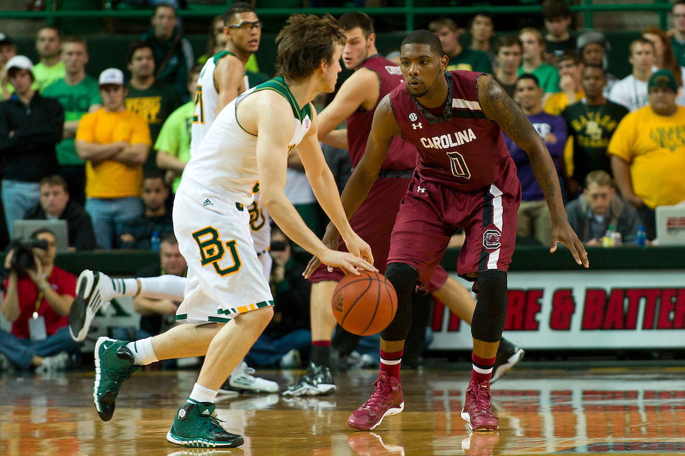 WACO, TX - NOVEMBER 12: Sindarius Thornwell #0 of the South Carolina Gamecocks defends Brady Heslip #5 of the Baylor Bears on November 12, 2013 at the Ferrell Center in Waco, Texas.  (Photo by Cooper Neill/Getty Images) *** Local Caption *** Sindarius Thornwell