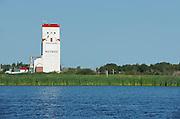 Grain elevator reflected in a wetland<br /> Whitewood<br /> Saskatchewan<br /> Canada