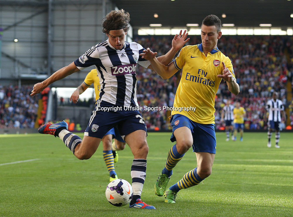 6th October 2013 - Barclays Premier League - West Bromwich Albion v Arsenal - Billy Jones of West Brom battles with Laurent Koscielny of Arsenal - Photo: Simon Stacpoole / Offside.