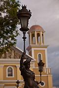 View of the ladies of Barcelona and cathedral of Nuestra Senora de la Candelaria in Plaza Colon, Mayaguez Puerto Rico