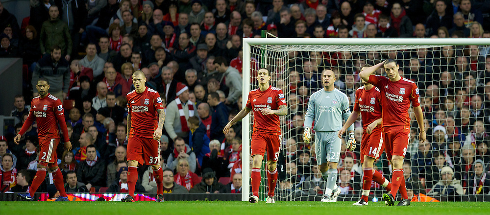 LIVERPOOL, ENGLAND - Boxing Day Monday, December 26, 2011: Liverpool's Glen Johnson, Martin Skrtel, Daniel Agger, goalkeeper Jose Reina, Jordan Henderson and Andy Carroll look dejected as Blackburn Rovers score the opening goal during the Premiership match at Anfield. (Pic by David Rawcliffe/Propaganda)