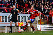 Mark Molesley keeps the ball in play during the The FA Cup match between Aldershot Town and Rochdale at the EBB Stadium, Aldershot, England on 7 December 2014.
