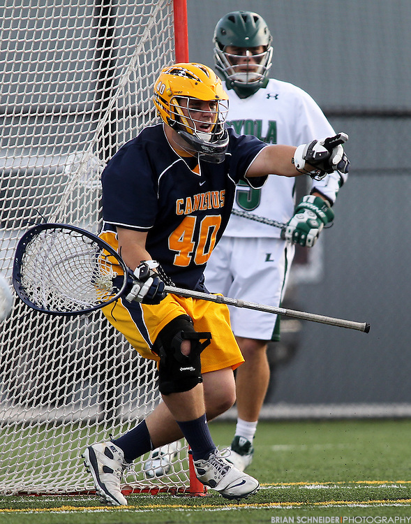 May 12, 2012; Baltimore, MD, USA; Canisius College Golden Griffins goalie Sean Callahan (40) makes a save against Loyola Maryland Greyhounds at Ridley Athletic Complex in Baltimore, MD. Mandatory Credit: Brian Schneider-www.ebrianschneider.com