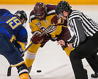 October 3, 2014.  Tempe, AZ.  Puck drop between the Arizona State University Pac8 and Northern Arizona State d3 teams.  Hayden Baardsen (29) and Kyle Mair (19) fight for possession. Image Credit: Amanda Schwarzer