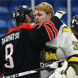 TRENTON, ON  - MAY 5,  2017: Canadian Junior Hockey League, Central Canadian Jr. &quot;A&quot; Championship. The Dudley Hewitt Cup Game 7 between Georgetown Raiders and the Powassan Voodoos.   Ryan Takamatsu #8 of the Georgetown Raiders hugs  Nate McDonald #33 of the Powassan Voodoos post game.<br /> (Photo by Alex D'Addese / OJHL Images)
