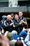 Graham Henry, Wayne Smith and Brad Thorn or the New Zealand All Blacks, 2011 Rugby World Cup champions, parade through the streets of Wellington. Rain and strong wind wasn't enough to deter Wellington locals from welcoming their heroes.