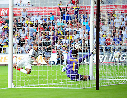 "Swansea City's Wayne Routledge scores his second with his head  - Photo mandatory by-line: Joe Meredith/JMP - Tel: Mobile: 07966 386802 22/08/2013 - SPORT - FOOTBALL - Liberty Stadium - Swansea -  Swansea City V Petrolul Ploiesti - Europa League Play-Off EDITORIAL USE ONLY. No use with unauthorised audio, video, data, fixture lists, club/league logos or ""live"" services. Online in-match use limited to 45 images, no video emulation. No use in betting, games or single club/league/player publications"