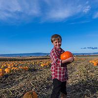 Pick n Patch, Union, Oregon: Aria, 3, Preston in green jacket, 7, Gavin older boy, 11, Ethan in red plaid, 5. Owner Dian Frisch.