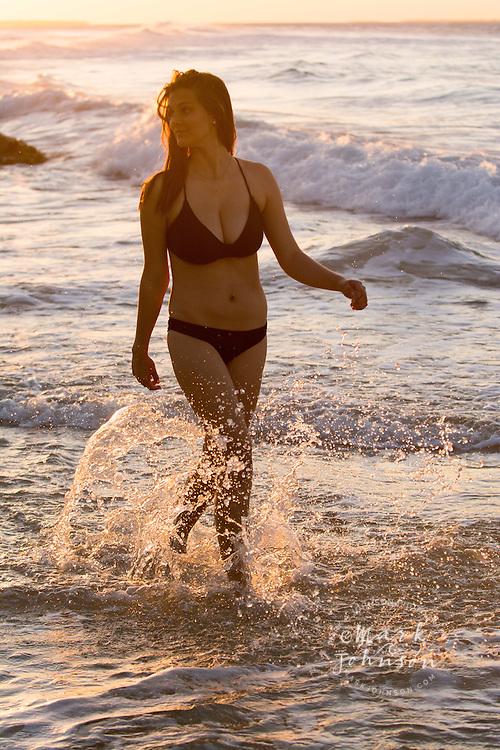 Young woman in a bikini on a beach, N. Stradbroke Island, Queensland, Australia