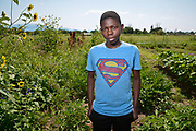 Wisungata Mukubilwa, 15, is a freshman at Highland High School.<br /> His family is from Congo, DRC<br /> He was born and raised in a refugee camp in Tanzania where he attended school. As a young boy he was not allowed to leave the camp. He said he didn&rsquo;t walk through the whole camp, because it was so big. <br /> <br /> He arrived in Albuquerque with his mother, father and six sisters, Sept. 9, 2016. His is the only boy in the family. He is a 9th grader at Highland High School and is learning English. &ldquo;I want to be a doctor,&rdquo; Wisungata said.  <br /> <br /> In the garden, he has learned to irrigate and to use the lawn mover. Zoey is teaching him to cultivate different plants. In the camp, there isn&rsquo;t much difference in what was grown there and in Tres Hermanas. Most of what they have here, they cultivated in their gardens in the camp. <br /> <br /> For Wisungata, one of the main differences between eating in Albuquerque and eating at the refugee camp is at the camp there was no pizza. In Albuquerque, he can find broccoli, juices, cereals and apples that were not available in the camp. He was able to find mango, avocado and oranges, but finding juice was not easy.