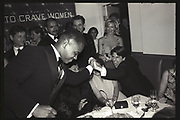 Tom Cruise greeting Cuba Gooding Jr. Group around includes Jim Carreyand Lauren Holly, ( standing)   at the Vanity Fair<br /> Oscar Night Party. Mortons. Los Angeles.  24 March 1997