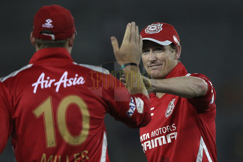 George BAILEY (Captain) of the Kings XI Punjab  congratulates David MILLER of the Kings XI Punjab on taking the catch to dismiss Jonathan CARTER of the Barbados Tridents  during match 5 of the Oppo Champions League Twenty20 between the Kings XI Punjab and the Barbados Tridents held at the Punjab Cricket Association Stadium, Mohali, India on the 20th September 2014<br /> <br /> Photo by:  Ron Gaunt / Sportzpics/ CLT20<br /> <br /> <br /> Image use is subject to the terms and conditions as laid out by the BCCI/ CLT20.  The terms and conditions can be downloaded here:<br /> <br /> http://sportzpics.photoshelter.com/gallery/CLT20-Image-Terms-and-Conditions-2014/G0000IfNJn535VPU/C0000QhhKadWcjYs