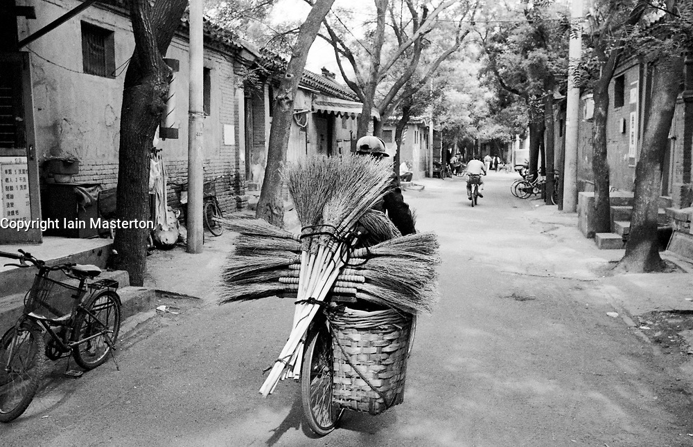 Brush salesman in old hutong in Beijing prior to demolition