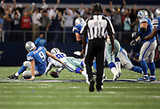 Dallas Cowboys rookie defensive end Demarcus Lawrence (90) recovers the loose ball after sacking Detroit Lions quarterback Matthew Stafford (9) with 54 seconds left in the fourth quarter on a fourth down play during the NFL week 18 NFC Wild Card postseason football game against the Detroit Lions on Sunday, Jan. 4, 2015 in Arlington, Texas. The Cowboys won the game 24-20. ©Paul Anthony Spinelli
