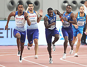 Zharnel Hughes takes the handoff from Adam Gemili (GBR) and Justin Gatlin takes the handoff from Christian Coleman (USA) on the second leg of a 4 x 100m relay heat during the IAAF World Athletics Championships,  Friday, Oct 4, 2019, in Doha, Qatar. (Claus Andersen/Image of Sport)