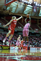 12 February 2012:  Candace Sykes pulls up for a short jumper just out of reach of Kelly Frings during an NCAA women's basketball game Where the Bradley Braves lost to the Illinois Sate Redbirds 82-63.  It was Play 4Kay day in honor of the cancer research fund set up by Coach Kay Yow at Redbird Arena in Normal IL
