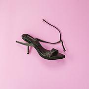 A worn-out fake Versace high heel.