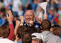 Russell Slade (Brighton Manager) is chaired off the pitch by the Fans after avoiding relegation. Brighton and Hove Albion v Stockport County League One 2/05/2009  Credit : Colorsport / Andrew Cowie