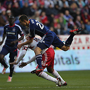 Austin Berry, Chicago Fire, climbs over Thierry Henry, New York Red Bulls, in action during the New York Red Bulls V Chicago Fire, Major League Soccer regular season match at Red Bull Arena, Harrison, New Jersey. USA. 27th October 2013. Photo Tim Clayton
