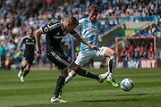 Konstantin Kerschbaumer (Brentford) takes a shot during the Sky Bet Championship match between Huddersfield Town and Brentford at the John Smiths Stadium, Huddersfield, England on 7 May 2016. Photo by Mark P Doherty.