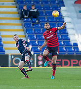 8th May 2018, Global Energy Stadium, Dingwall, Scotland; Scottish Premiership football, Ross County versus Dundee; Steven Caulker of Dundee clears from Billy McKay of Ross County