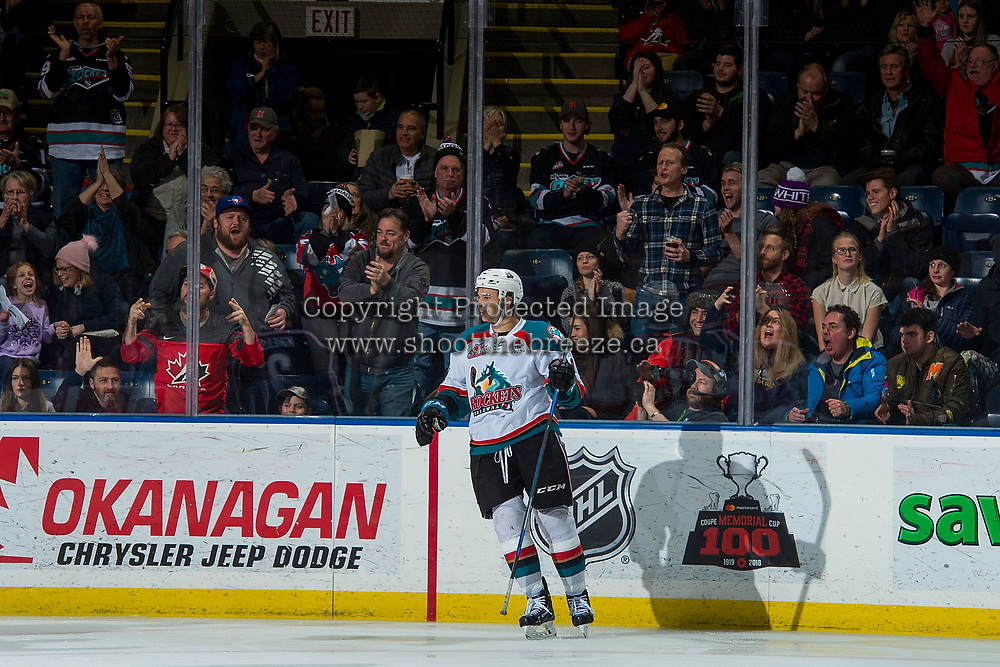 KELOWNA, CANADA - JANUARY 3: Carsen Twarynski #18 of the Kelowna Rockets stands at the boards to celebrate a goal against the Tri-City Americans on January 3, 2017 at Prospera Place in Kelowna, British Columbia, Canada.  (Photo by Marissa Baecker/Shoot the Breeze)  *** Local Caption ***