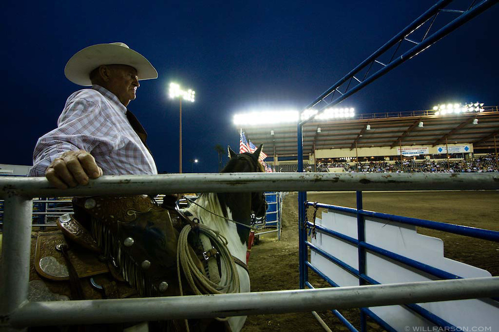 Cotton Rosser, owner of Flying U Rodeo Company and Cowboy Hall of Fame inductee, waits to enter the arena at the start of the PBR rodeo at the Del Mar Fairgrounds in Del Mar, California on July 27th, 2008.  It was the second night of the PBR's tour stop in Del Mar.