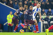 Arsenal forward ALexandre Lacazette (9) battles with Brighton and Hove Albion midfielder Dale Stephens (6) during the Premier League match between Brighton and Hove Albion and Arsenal at the American Express Community Stadium, Brighton and Hove, England on 26 December 2018.