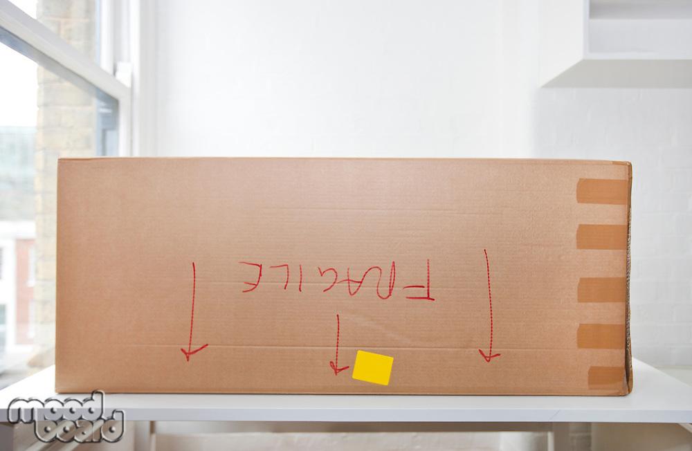 "Cardboard box marked ""fragile"" upside down"