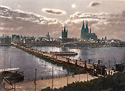 Cologne, Germany,  1890-1905. Moonlight view of the city looking across the river Rhine  with the Cathedral on the right.
