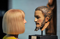 © Licensed to London News Pictures. 27/06/2017. London, UK.  A visitor views an Italian wooden portrait head circa 1550 at The Arts & Antiques Fair taking place at Olympia in Kensington.  The event is the UK's largest and most established art and antiques fair and runs until 2 July. Photo credit : Stephen Chung/LNP