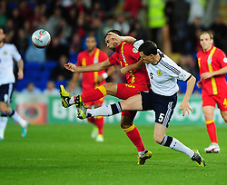 Scotland's Gary Caldwell (Wigan) battles for the ball with Wales Joe Ledley (Celtic) - Photo mandatory by-line: Joe Meredith/JMP  - Tel: Mobile:07966 386802 12/10/2012 - Wales v Scotland - SPORT - FOOTBALL - World Cup Qualifier -  Cardiff   - Cardiff City Stadium -