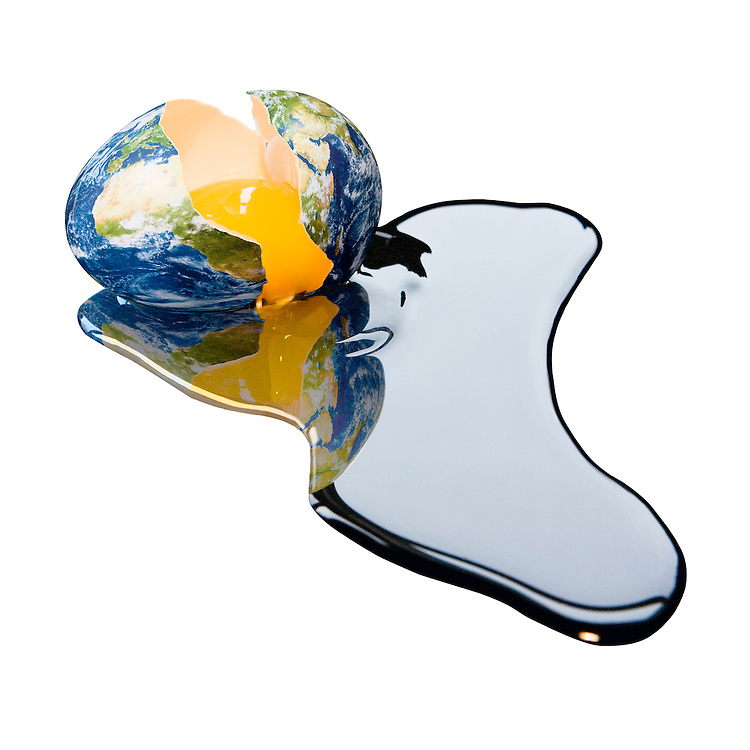 Photo illustration of the Earth as a broken egg, drained of egg white, which in this case is as black as oil.