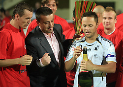 Ermin Rakovic, captain of Interblock with a champaign, at left club president Joc Pececnik and Suvad Grabus, right Erik Salkic,  at Slovenian Supercup between NK Domzale and NK Interblock, on July 9, 2008, in Domzale. Interblock won the mach and Supercup by 7 : 6 after penalty shots. (Photo by Vid Ponikvar / Sportal Images)