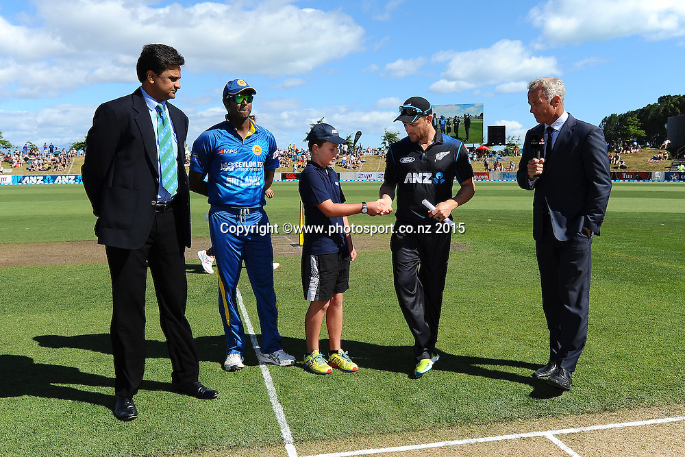ANZ Coin toss winner hands R-L Brendon McCullum the coin for the coin toss. Match 4 of the ANZ One Day International Cricket Series between New Zealand Black Caps and Sri Lanka at Saxton Oval, Nelson, New Zealand. Tuesday 20 January 2015. Copyright Photo: Chris Symes/www.Photosport.co.nz