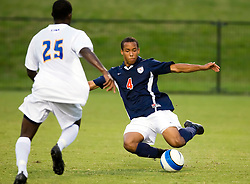 Virginia Cavaliers defender T.J. Cyrus (4) slides for the ball in front of Hofstra forward Brett Carrington (25).  The Virginia Cavaliers faced the Hofstra Pride  in NCAA men's soccer at Klockner Stadium on the Grounds of the University of Virginia in Charlottesville, VA on September 7, 2008