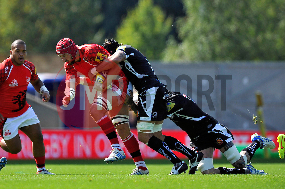 Peter Browne (London Welsh) is tackled - Photo mandatory by-line: Patrick Khachfe/JMP - Mobile: 07966 386802 06/09/2014 - SPORT - RUGBY UNION - Oxford - Kassam Stadium - London Welsh v Exeter Chiefs - Aviva Premiership
