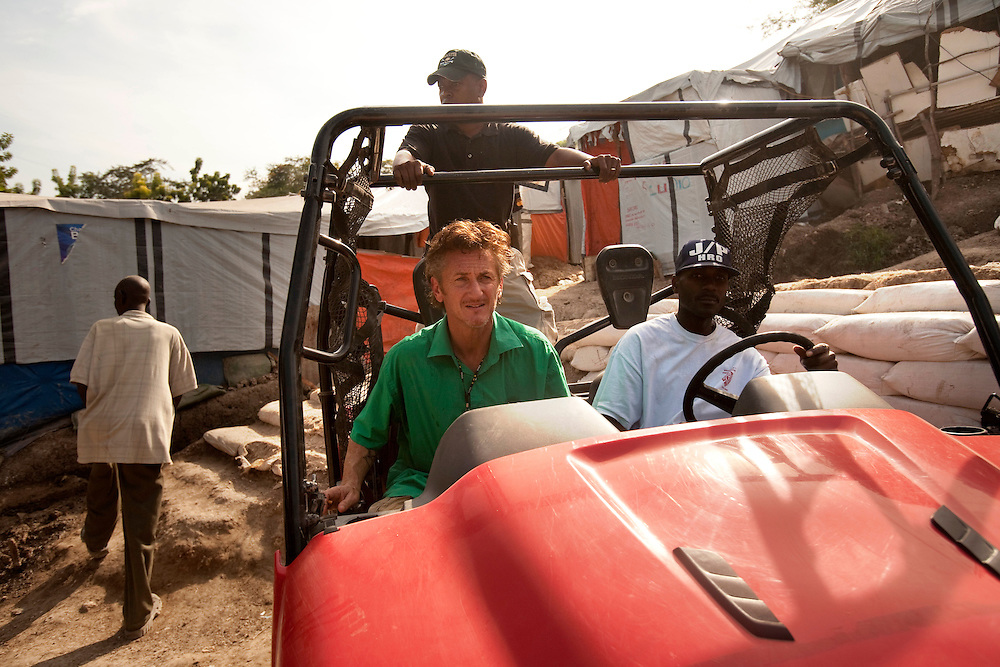 Actor and Founder of J/P HRO Refugee Camp, Sean Penn, meets with refugees after a massive earthquake hit Haiti.Wednesday December 1.2010The camp is estimated to have over 55,000 refugees..almost  year after a catastrophic earthquake measuring 7.3 on the Richter scale hit Haiti on January 13, 2010, killing an estimated 230,000 people, injuring an estimated 300,000 and making homeless an estimated 1,000,000..
