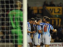 Huddersfield Town's Harry Bunn celebrates with his team mates after scoring. - Photo mandatory by-line: Dougie Allward/JMP - Mobile: 07966 386802 - 01/10/2014 - SPORT - Football - Wolverhampton - Molineux Stadium - Wolverhampton Wonderers v Huddersfield Town - Sky Bet Championship