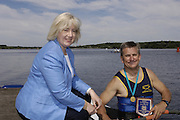 2006, National Rowing Championships,  Strathclyde Country Park,  Motherwell, SCOTLAND. Patricia FERGUSON, SMP, Minister of tourism, Culture and Sport, presenting, Rob HOLLIDAY from the - Ardingly Rowing Club, his Gold Medal and Plaque for winning the OA1X,  Sunday, 16.07.2006.  Photo  Peter Spurrier/Intersport Images email images@intersport-images.com. Finals Day.... Rowing Course, Strathclyde Country Park,  Motherwell, SCOTLAND.