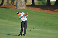 Golfer Jhonattan Vegas swings on the 10th hole at the PGA FedEx St. Jude Classic at TPC Southwind in Memphis, Tenn. on Thursday, June 9, 2011.