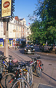 ATBK1D Black taxi cab and bicycles central Norwich Norfolk England