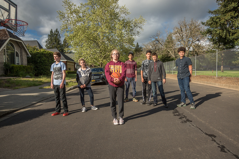 PUCE seventh and eighth grade students Londyn, Ashtyn, Lia, Michael, Trevor, Tyler and Ben pause from their pick-up basketball game on Centennial Circle in Calistoga.