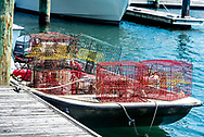 A small boat or dinghy with crab traps tied to dock at Beaufort, North Carolina on the Crystal Coast or Southern Outer Banks ready for crabbing.